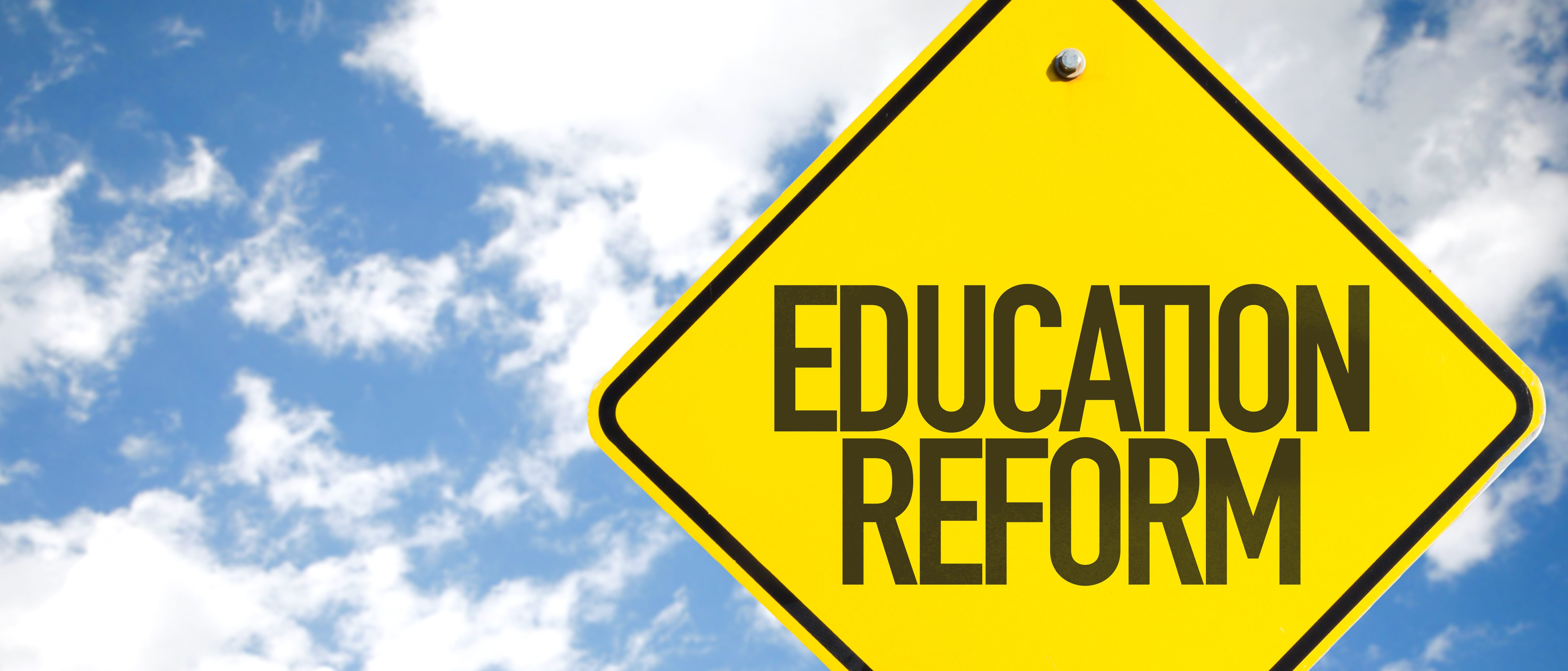 Education Reform sign with sky background. (Shutterstock/Gustavo Frazao)