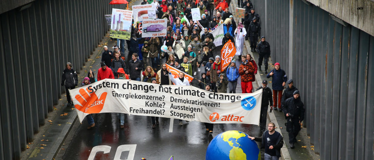 People march during a demonstration in Bonn against the COP 23 UN Climate Change Conference hosted by Fiji but held in Bonn, Germany November 11, 2017. REUTERS/Wolfgang Rattay