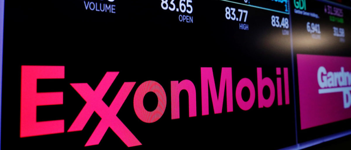 A logo of Exxon Mobil is displayed on a monitor above the floor of the New York Stock Exchange shortly after the opening bell in New York, U.S., December 5, 2017.  REUTERS/Lucas Jackson