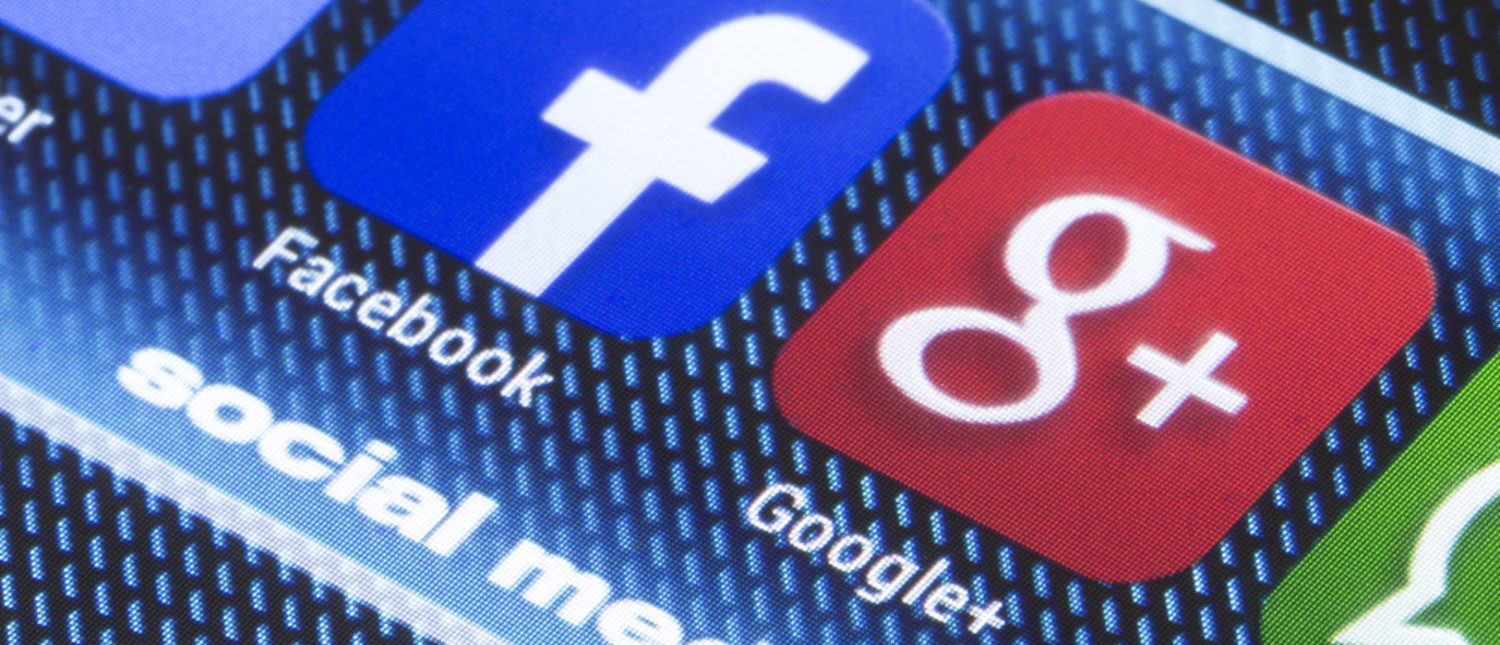 Social media icons on a smartphone screen, like Google+ an Facebook. [Shutterstock - quka]