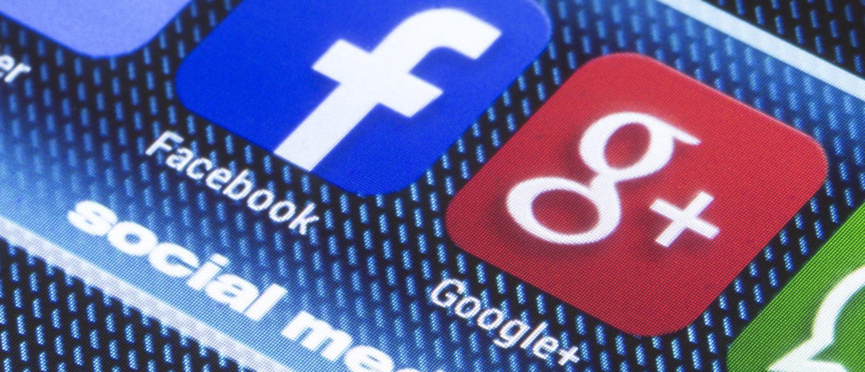 Social media icons on a smartphone screen, like Google+ an Facebook. [Shutterstock - quka]