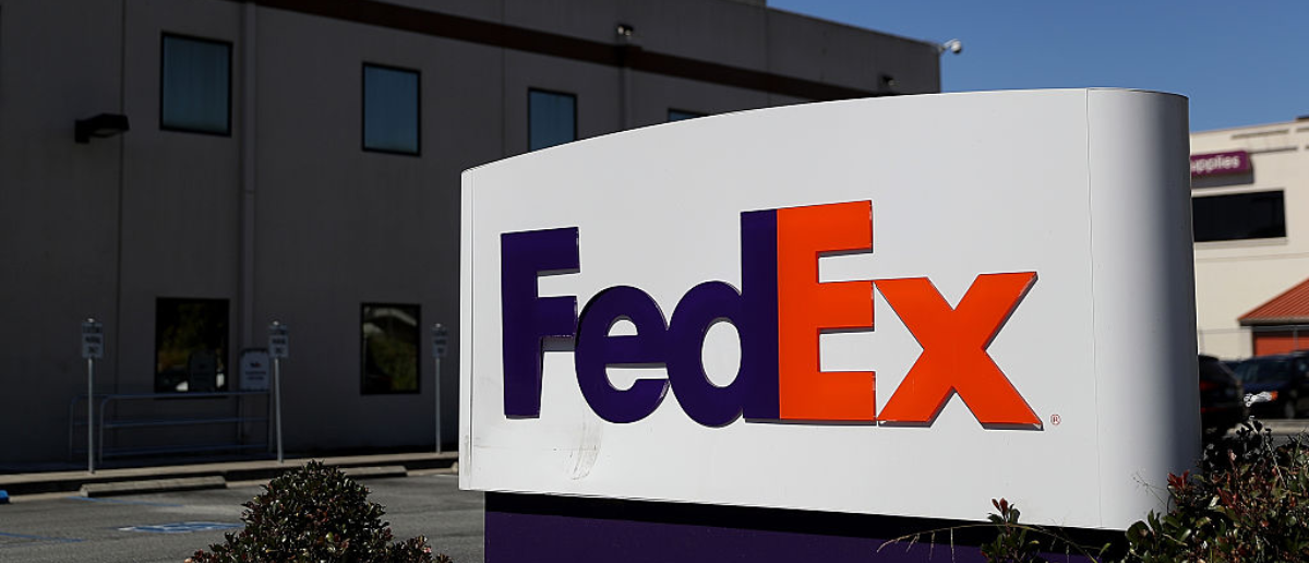 SAN FRANCISCO, CA - JUNE 21: A sign is posted in front of a FedEx shipping center on June 21, 2016 in San Francisco, California. FedEx Corp. is will announce its fourth-quarter earnings today after the closing bell. (Photo by Justin Sullivan/Getty Images)