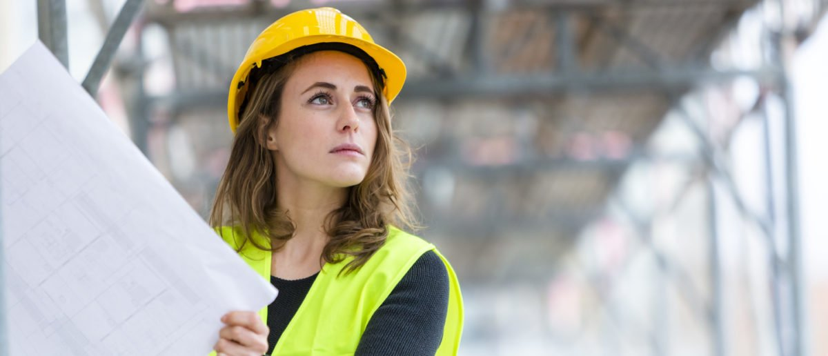 Female construction site engineer. (Shutterstock/Cineberg)