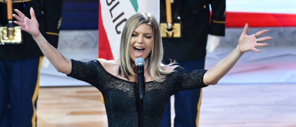 LOS ANGELES, CA - FEBRUARY 18: Singer Fergie sings the national anthem prior to The 67th NBA All-Star Game: Team LeBron Vs. Team Stephen at Staples Center on February 18, 2018 in Los Angeles, California. (Photo by Allen Berezovsky/Getty Images)