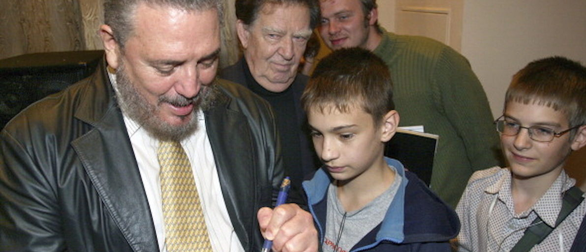 Fidel Castro Jr. signs an autograph for a child at a meeting with Nobel Prize Physicist Jores Alferov in St. Petersburg, 05 October 2007. Castro spoke to a group of elementary and university students at the request of Alferov. AFP PHOTO / SERGEY KULIKOV (Photo credit should read SERGEY KULIKOV/AFP/Getty Images)