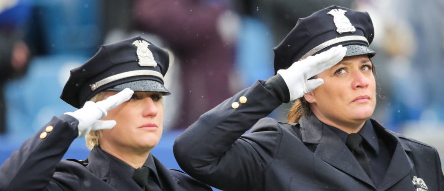 ORCHARD PARK, NY - OCTOBER 29: Buffalo first responders salute while honoring Buffalo Police Officer Craig Lehner before an NFL game between the Buffalo Bills and Oakland Raiders on October 29, 2017 at New Era Field in Orchard Park, New York. (Photo by Brett Carlsen/Getty Images)