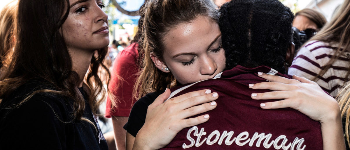 Students from Marjory Stoneman Douglas High School attend a memorial following a school shooting incident in Parkland, Florida, U.S., February 15, 2018. REUTERS/Thom Baur