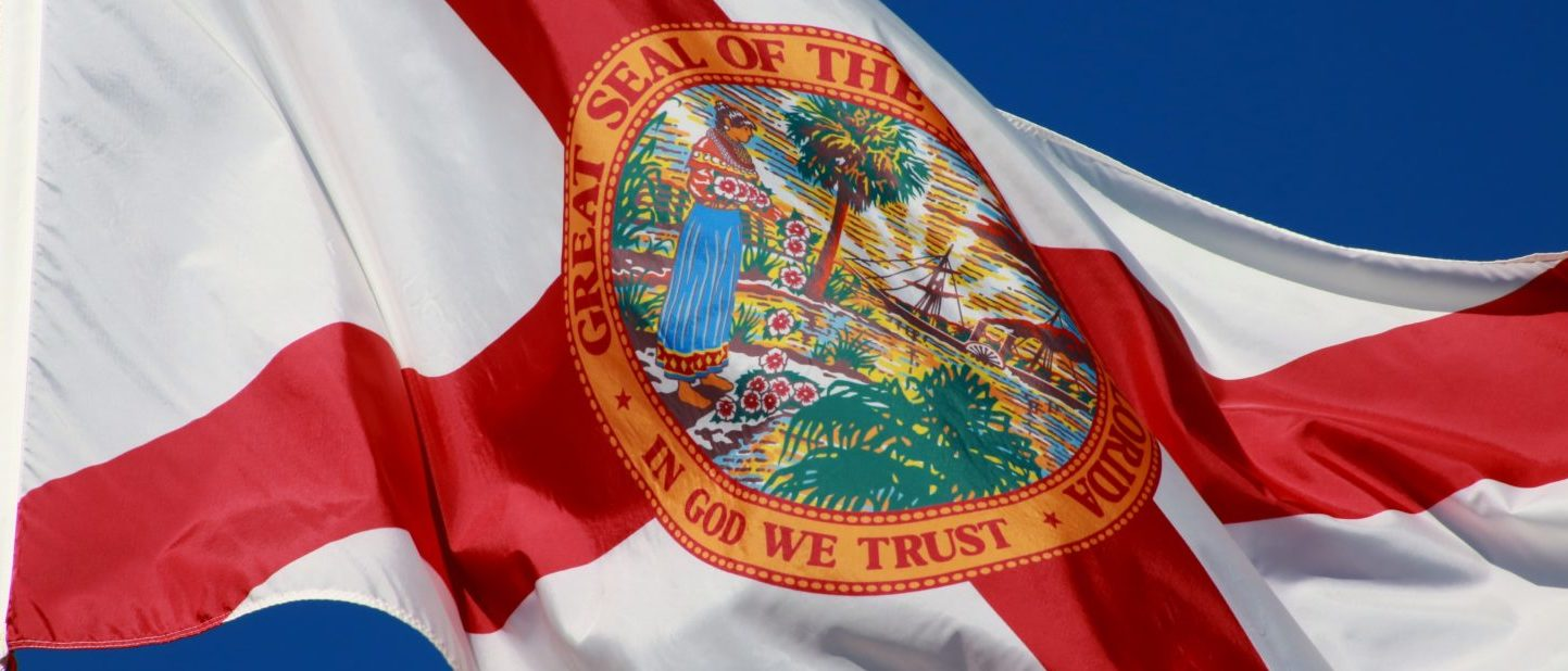Florida State Flag with 'In God We Trust' on the seal (Shutterstock/ Mike Kuhlman)