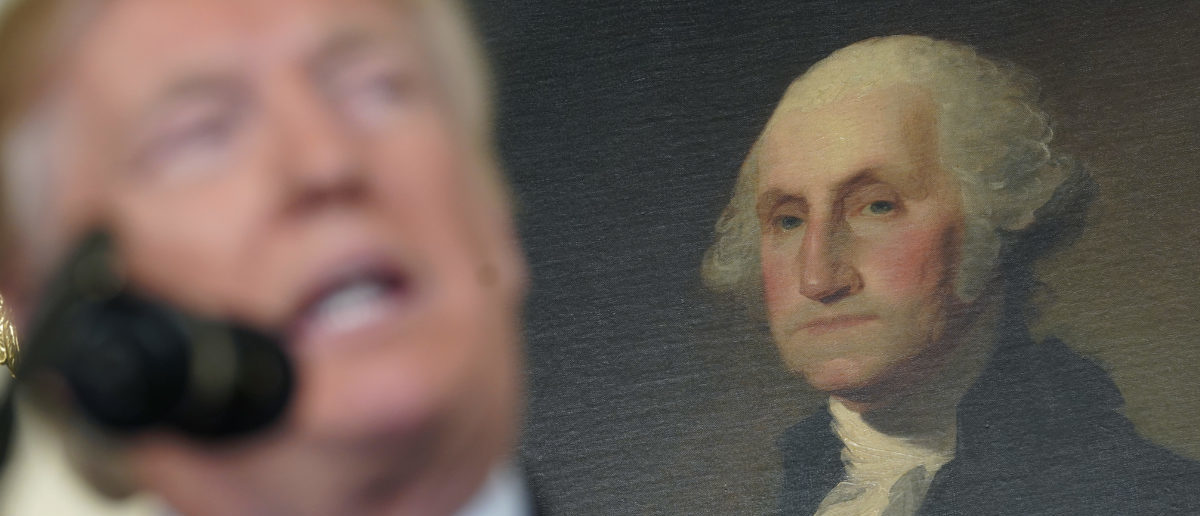 A portrait of President George Washington over the shoulder of President Donald Trump in the White House. Washington, U.S., November 15, 2017. REUTERS/Joshua Roberts