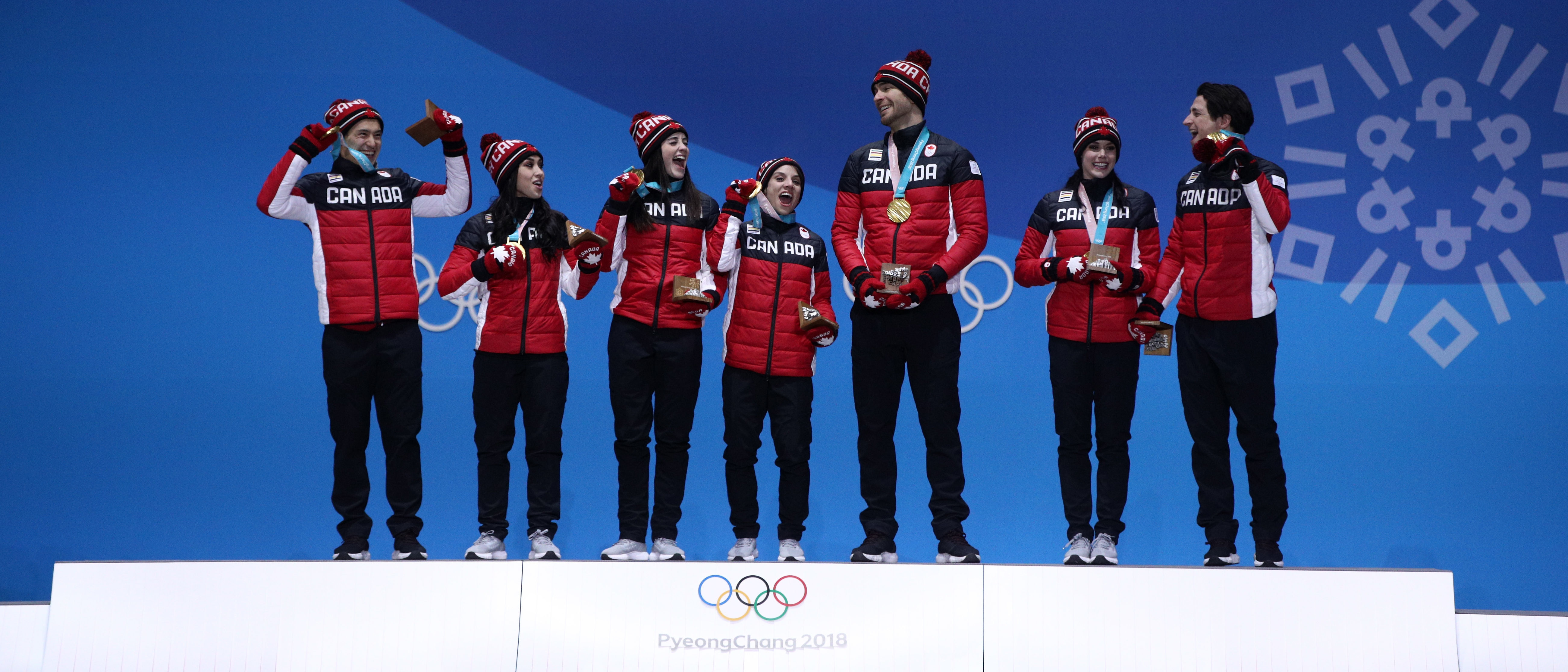 PYEONGCHANG-GUN, SOUTH KOREA - FEBRUARY 12: Gold medalists (L-R) Patrick Chan, Gabrielle Daleman, Kaetlyn Osmond, Meagan Duhamel, Eric Radford, Tessa Virtue and Scott Moir of Team Canada celebrate during the medal ceremony after the Figure Skating Team Event at Medal Plaza on February 12, 2018 in Pyeongchang-gun, South Korea. (Photo by Adam Pretty/Getty Images)