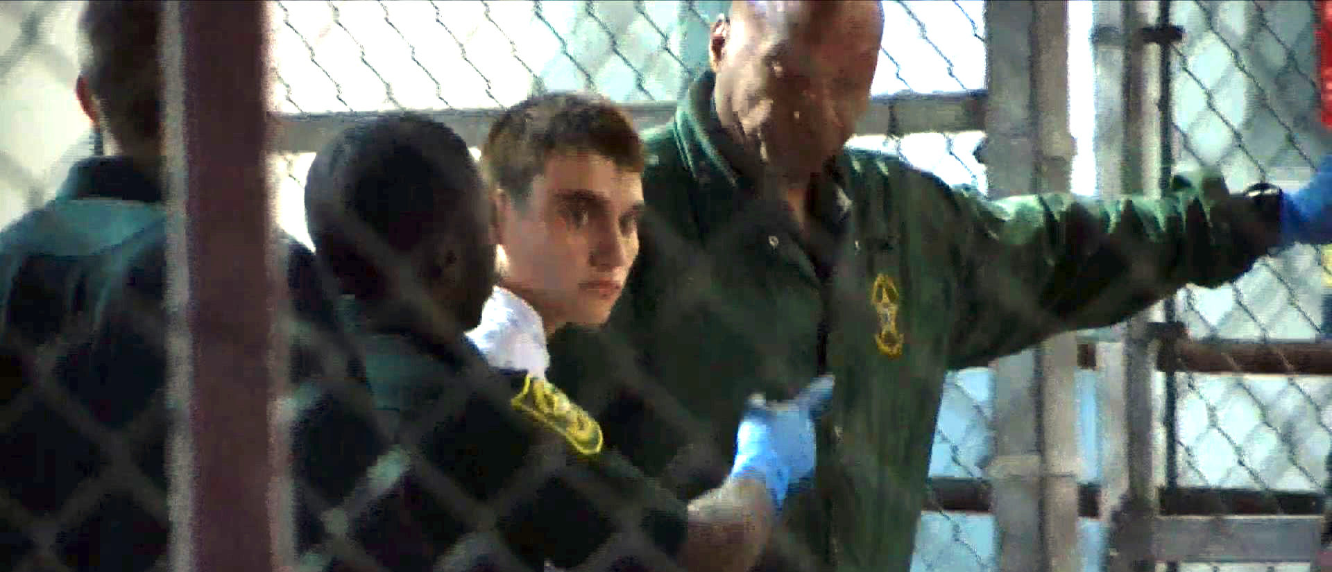 This video screen grab image shows shooting suspect Nikolas Cruz on February 15, 2018 at Broward County Jail in Ft. Lauderdale, Florida. The heavily armed teenager who gunned down students and adults at a Florida high school was charged Thursday with 17 counts of premeditated murder, court documents showed. Nikolas Cruz, 19, killed fifteen people in a hail of gunfire at Marjory Stoneman Douglas High School in Parkland, Florida. Two others died of their wounds later in hospital, the sheriff's office said. / AFP PHOTO / AFP TV / Miguel GUTTIEREZ