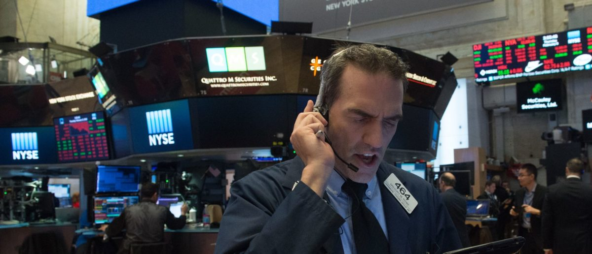 Traders work on the floor at the closing bell of the Dow Industrial Average at the New York Stock Exchange on Wall Street on February 8, 2018 in New York.  Traders work on the floor at the closing bell of the Dow Industrial Average at the New York Stock Exchange on Wall Street on February 8, 2018 in New York.  Wall Street tumbled back into sell-off mode Thursday, with the Dow plunging more than 1,000 points as worries over interest rate hikes continued to drag the market down. At the closing bell, the Dow Jones Industrial Average was at 23,858.90, down 4.2 percent. (Photo: BRYAN R. SMITH/AFP/Getty Images)