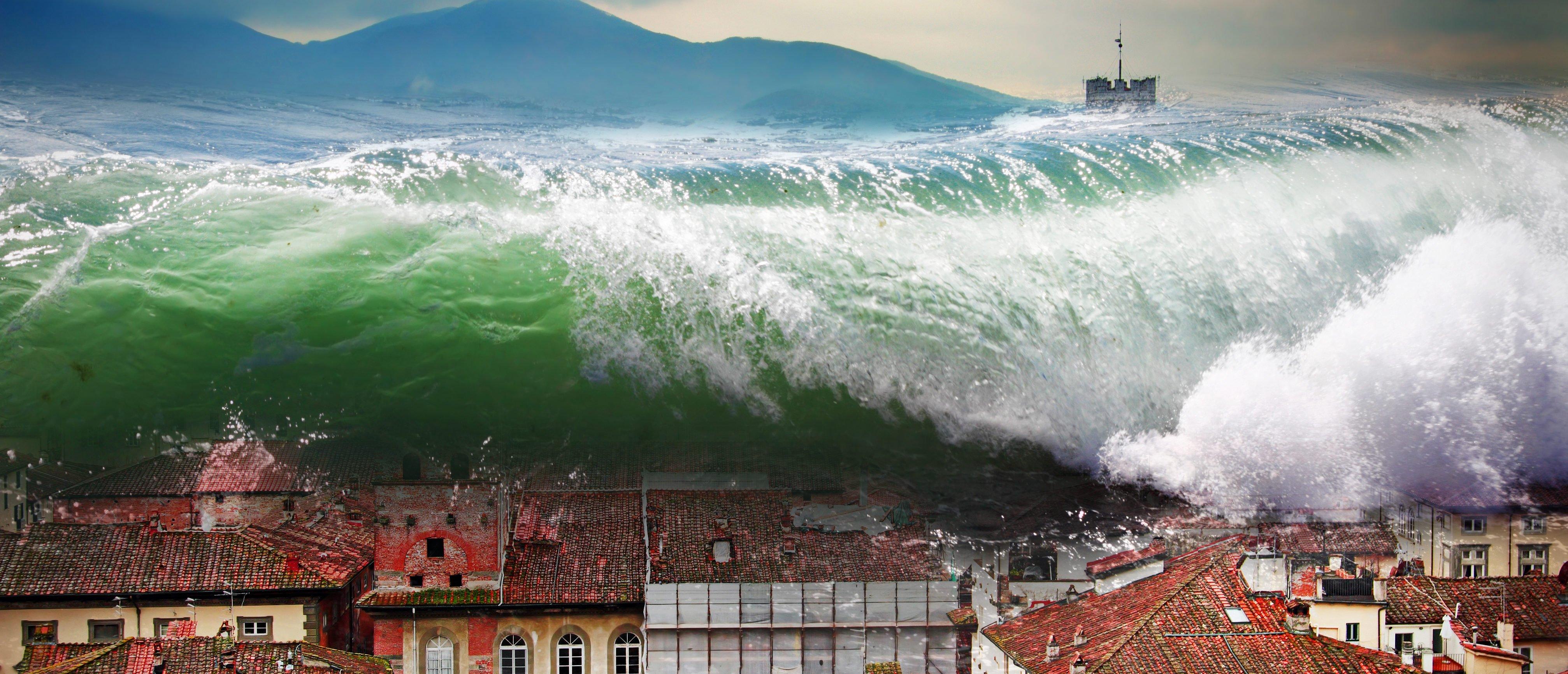 Giant wave crashing above the city. Global flood. (Shutterstock/iryna1)