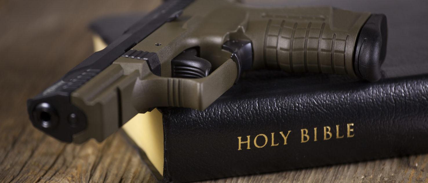 A Gun And A Bible (Shutterstock/ Lonny Garris)