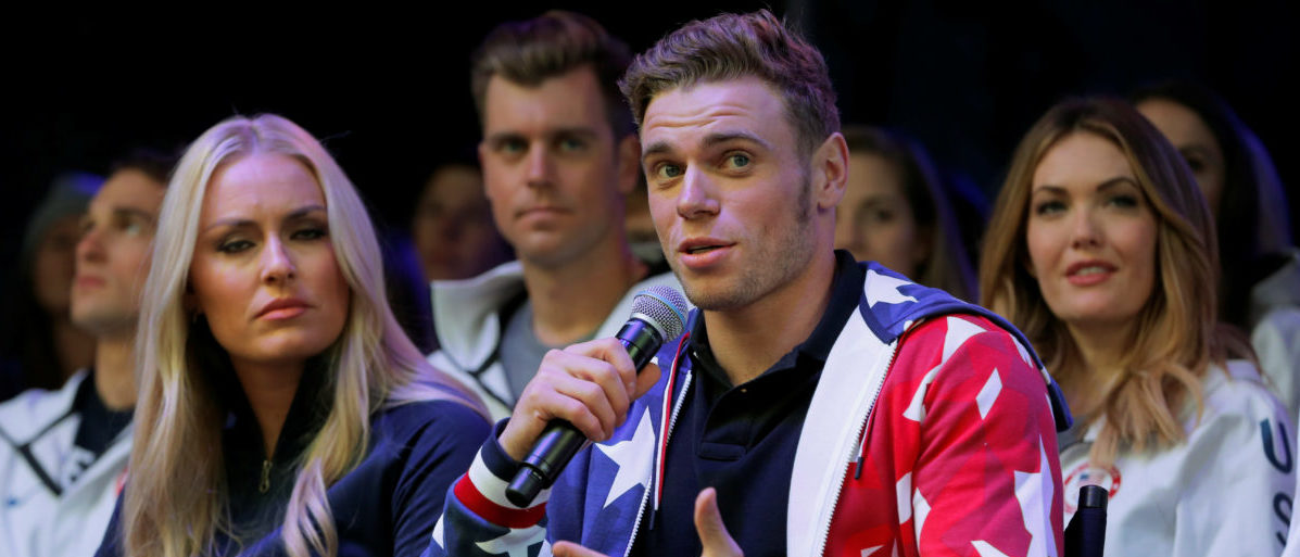 Olympian freestyle skier Gus Kenworthy speaks next to skier Lindsey Vonn during an event in Times Square to celebrate 100 days from the start of the PyeongChang 2018 Olympic Games in South Korea, in New York, U.S., November 1, 2017. REUTERS/Lucas Jackson - RC16010C2560