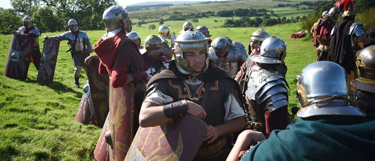 Reenactors portraying soldiers from the Imperial Roman Army prepare for a battle with Caledonian barbarians during English Heritage's history weekend, 'Hadrians Wall Live', at Birdoswald Roman Fort near Gilsland, northern England on September 6, 2015. The 'Hadrian's Wall Live' event, which takes place on September 5 and 6, features Roman history reenactments taking place at various points along the length of the World Heritage Site fortification, including a battle between the Barbarian and Roman Soldiers of 143 AD. AFP PHOTO / OLI SCARFF (Photo credit should read OLI SCARFF/AFP/Getty Images)