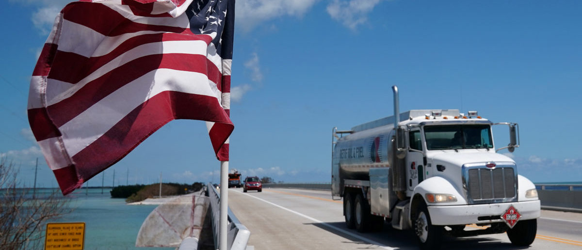 A truck delivering fuel passes a U.S. flag on a highway US 1 following Hurricane Irma in Islamorada, Florida, U.S., September 15, 2017. REUTERS/Carlo Allegri | US Lost $154M Fuel To Afghan Corruption
