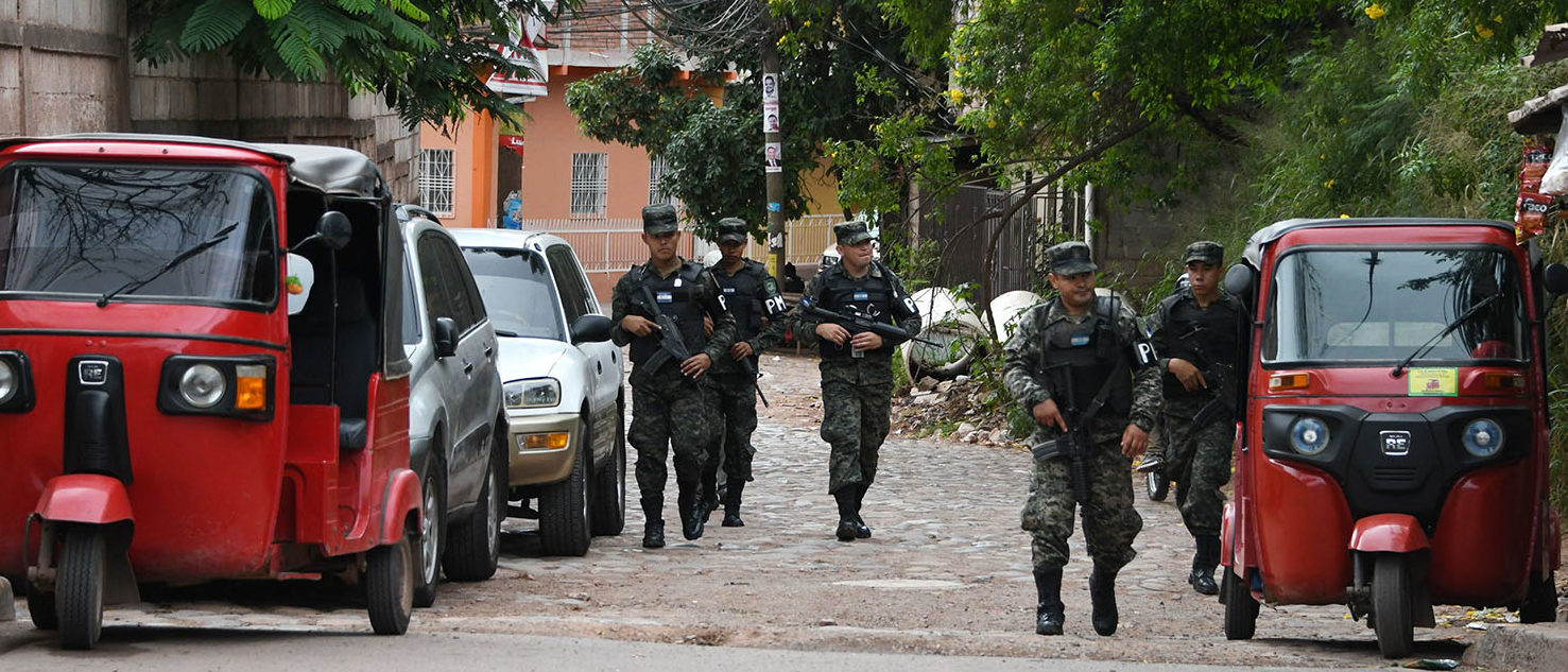 Members of the Military Police of Public Order (PMOP) take part in an operation against gangs Barrio 18 and Mara Salvatrucha (MS-13), on November 15 2017 in neighbourhoods of Tegucigalpa where residents were threatened if they vote in the November 26 general election. ORLANDO SIERRA/AFP/Getty Images