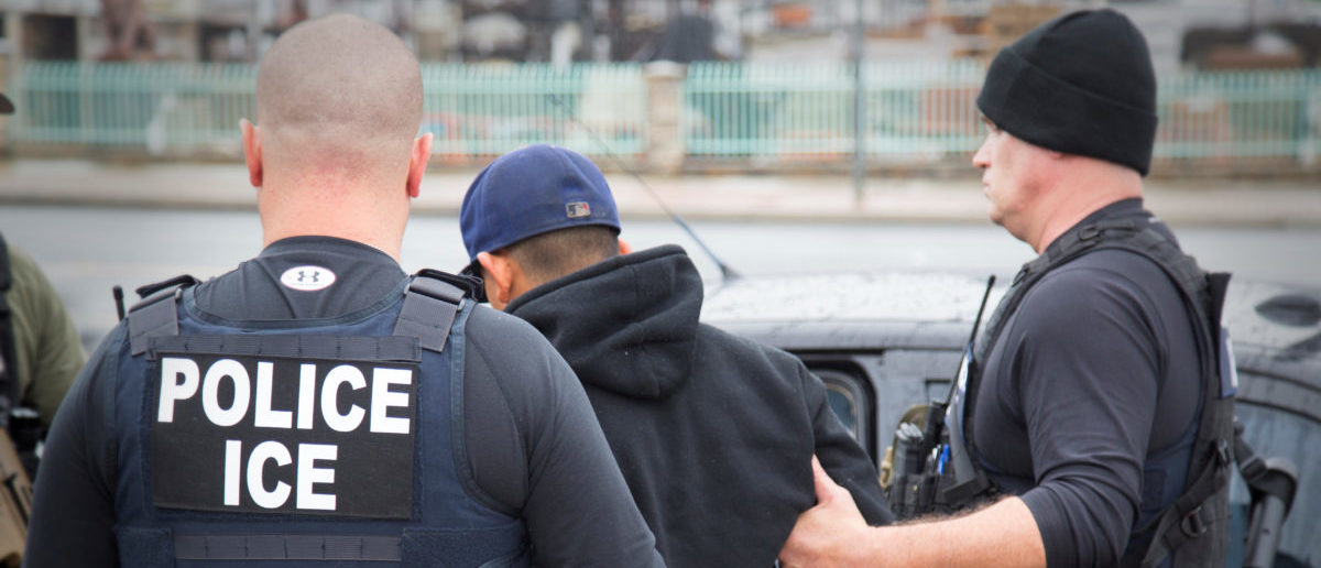 U.S. Immigration and Customs Enforcement (ICE) officers detain a suspect as they conduct a targeted enforcement operation in Los Angeles, California, U.S. on February 7, 2017. Picture taken on February 7, 2017. Courtesy Charles Reed/U.S. Immigration and Customs Enforcement via REUTERS