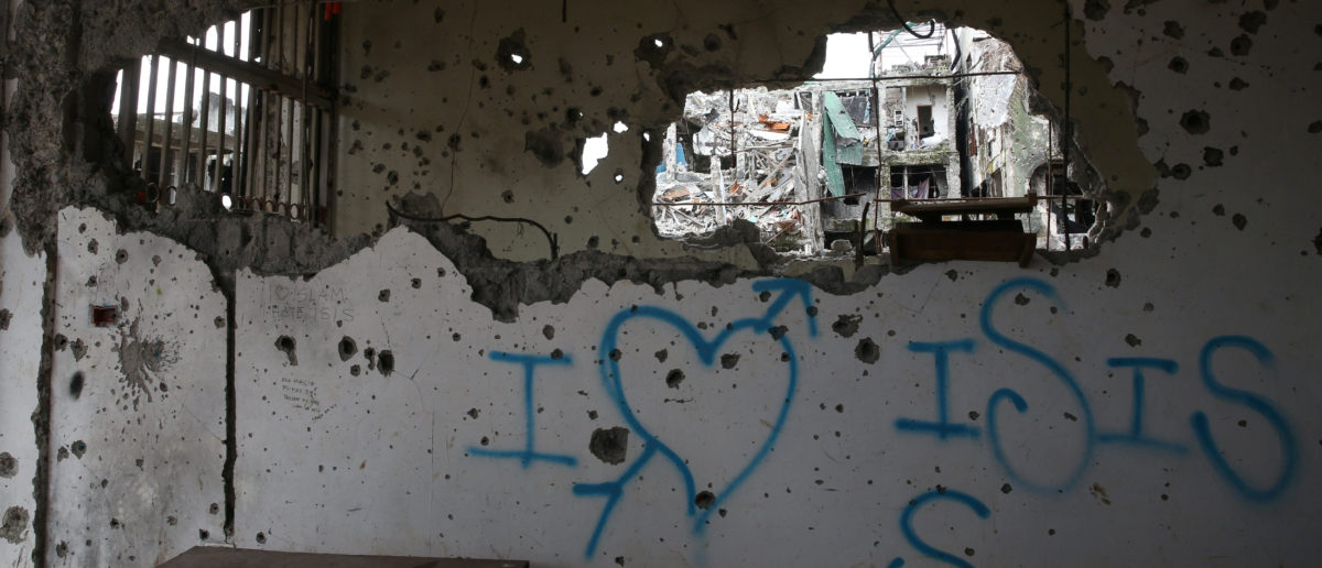 "A graffiti that reads ""I love ISIS"" is seen in a damaged building in Marawi city, Philippines, October 25, 2017. REUTERS/Romeo Ranoco"