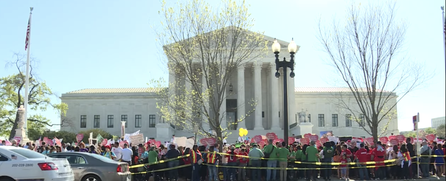 Immigration activists rally at the Supreme Court in 2016. (YouTube screenshot/AFP News Agency)