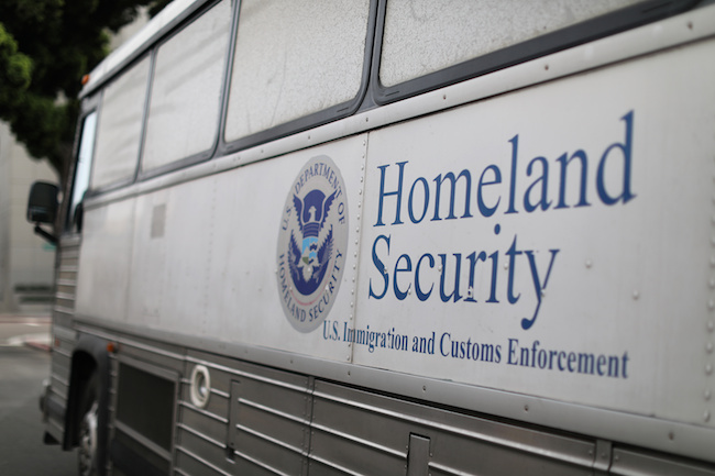 A Homeland Security Immigration and Customs Enforcement (ICE) bus is seen parked outside a federal jail in San Diego, California, October 19, 2017. REUTERS/Mike Blake