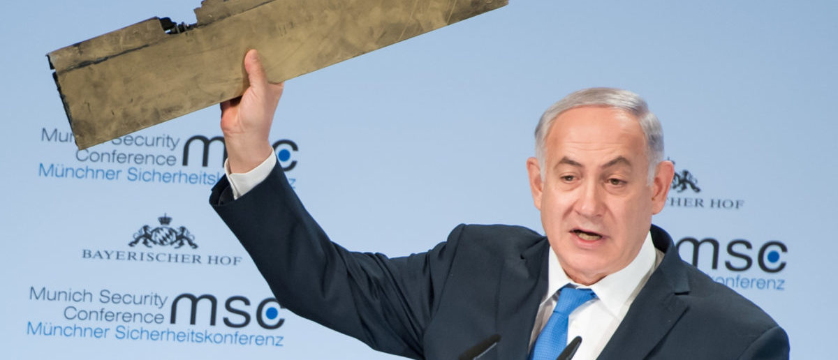 Israeli Prime Minister Benjamin Netanyahu holds up a remnant of what he said was a piece of Iranian drone which was shot down in Israeli airspace during his speech at the Munich Security Conference, Germany February 18, 2018. Lennart Preiss/MSC Munich Security Conference/Handout via REUTERS