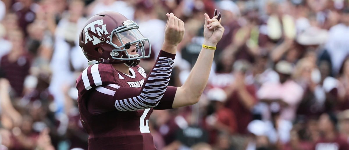 COLLEGE STATION, TX - AUGUST 31:  Johnny Manziel #2 of the Texas A&M Aggies celebrates a third quarter touchdown during the game against the Rice Owls at Kyle Field on August 31, 2013 in College Station, Texas.  (Photo by Scott Halleran/Getty Images)