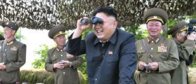 North Korean leader Kim Jong Un looks through a pair of binoculars during an inspection of the Hwa Islet Defence Detachment standing guard over a forward post off the east coast of the Korean peninsula, in this undated photo released by North Korea's Korean Central News Agency (KCNA) in Pyongyang on July 1, 2014. REUTERS/KCNA