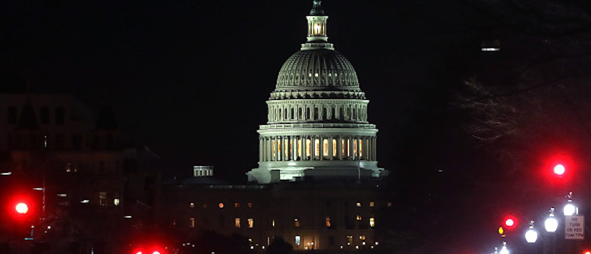 WASHINGTON, DC - FEBRUARY 09: Lights shine down Pennsylvania Avenue leading to the U.S. Capitol in the early hours of Friday morning on February 9, 2018 in Washington, DC. Despite an attempt by Sen. Rand Paul (R-KY) to slow down the process, the Senate passed bipartisan legislation to continue to fund the government and lift strict budget caps. With the government officially in a shut- down, the legislation now goes to the House of Representatives which is expected to vote to reopen the Government early Friday morning. (Photo by Mark Wilson/Getty Images)
