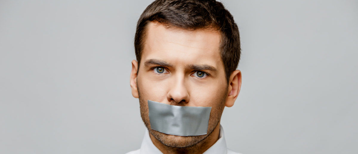 A professor is literally censored with a piece of tape. (Shutterstock/Anatolii Riepin)