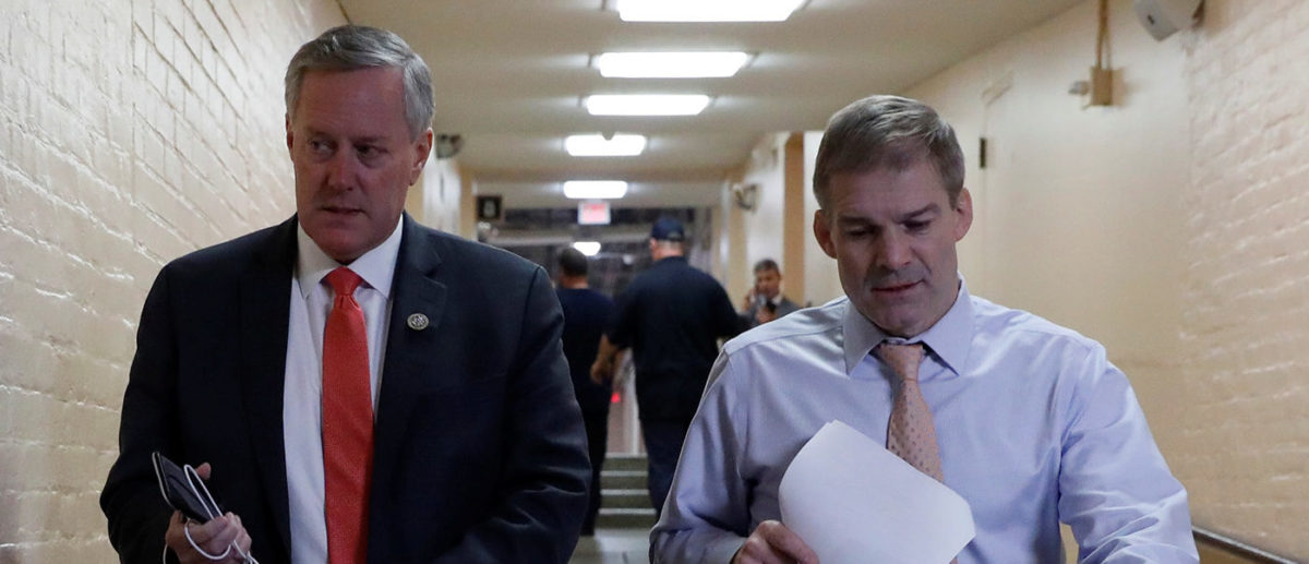 Rep. Mark Meadows (R-NC), left, and Rep. Jim Jordan (R-OH), arrive for a Republican conference meeting at the U.S. Capitol in Washington, U.S., December 20, 2017. REUTERS/Aaron P. Bernstein