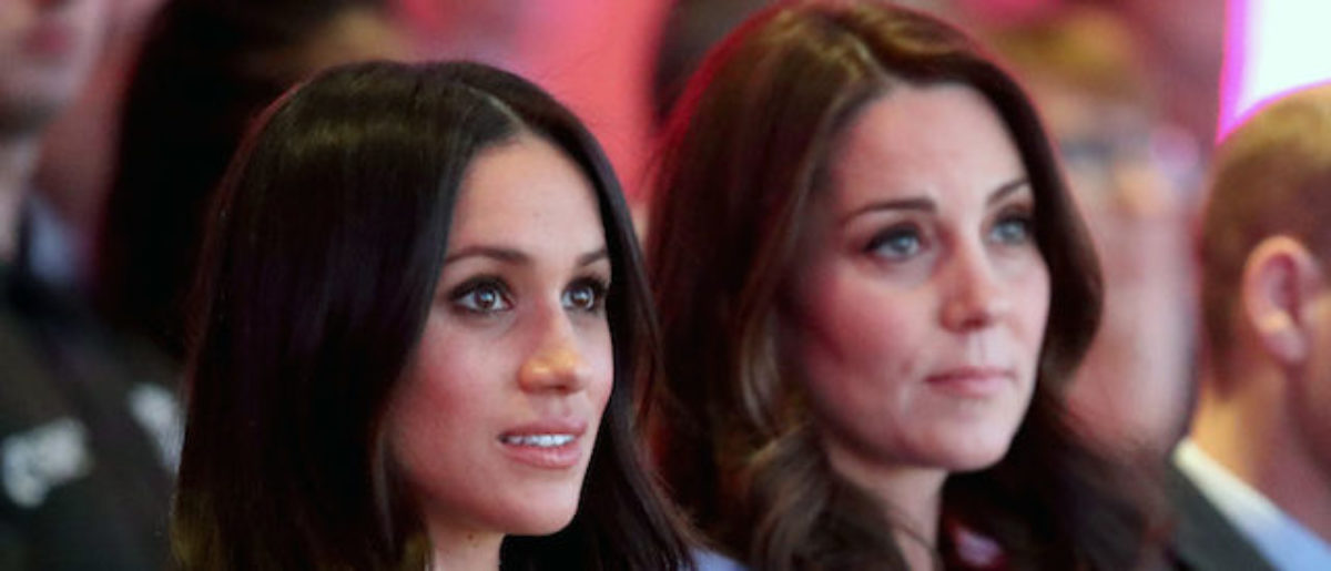 US actress and fiancee of Britain's Prince Harry Meghan Markle (L) and Britain's Catherine, Duchess of Cambridge attend the first annual Royal Foundation Forum on February 28, 2018 in London. (Photo credit: CHRIS JACKSON/AFP/Getty Images)