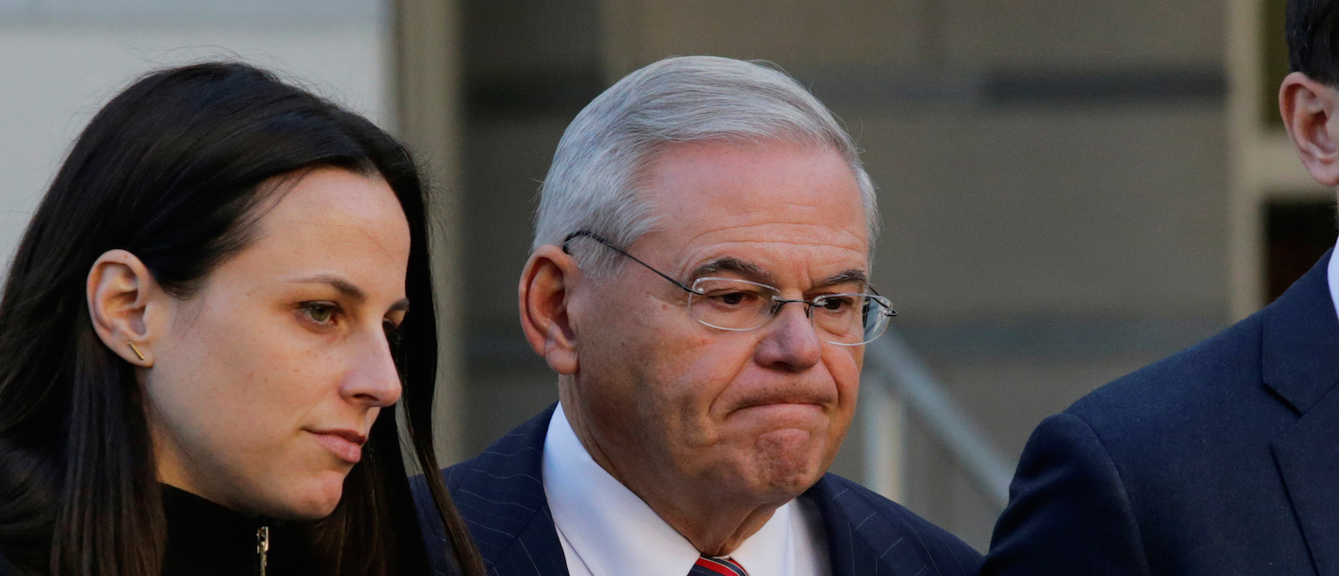 U.S. Senator Robert Menendez (D-NJ) departs the United States Court with his children Alicia Menendez and Robert Melendez, Jr., after his corruption trial ended in a mistrial, in Newark, New Jersey, U.S., November 16, 2017. REUTERS/Eduardo Munoz -