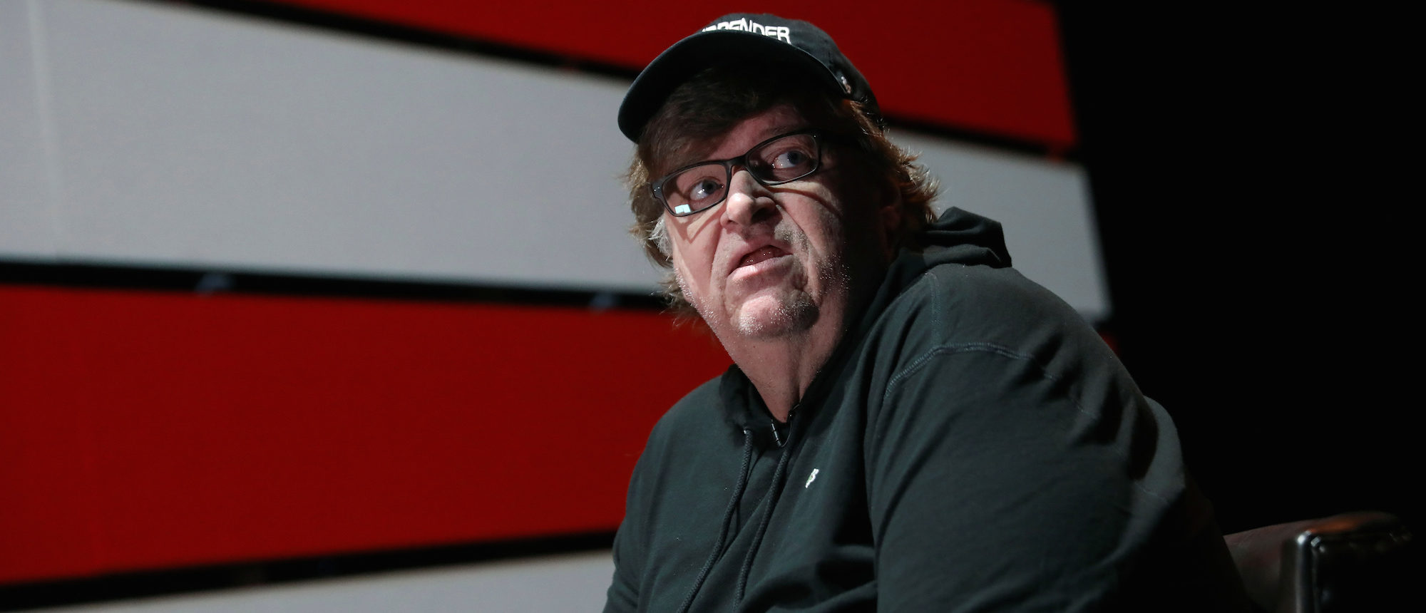 Michael Moore looks off stage during an interview at the site of his one-man Broadway show at the Belasco Theatre in Manhattan, New York, August 17, 2017.  REUTERS/Shannon Stapleton