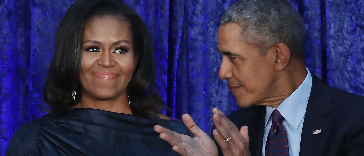 Former U.S. President Barack Obama and first lady Michelle Obama participate in the unveiling of their official portraits during a ceremony at the Smithsonian's National Portrait Gallery, on February 12, 2018 in Washington, DC. (Photo: Mark Wilson/Getty Images)