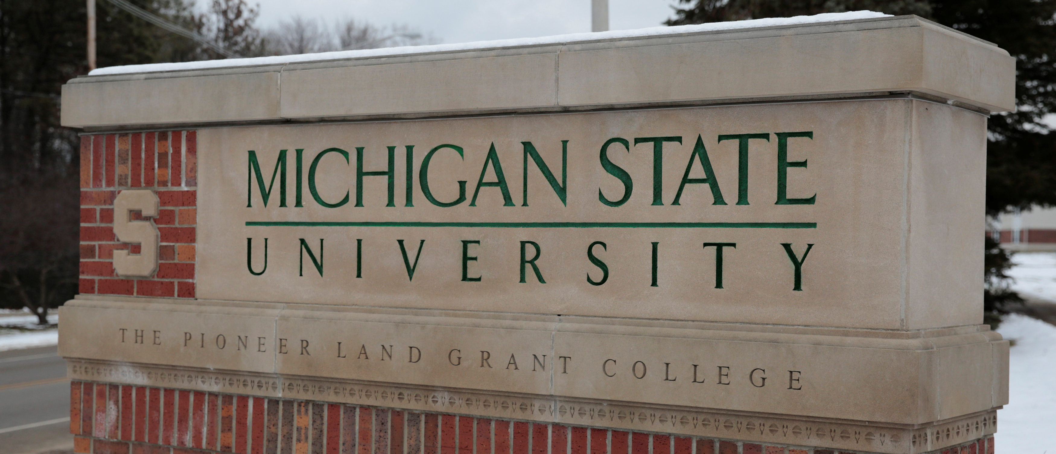 A sign for Michigan State University is seen near the campus in East Lansing, Michigan, February 1, 2018. REUTERS/Rebecca Cook
