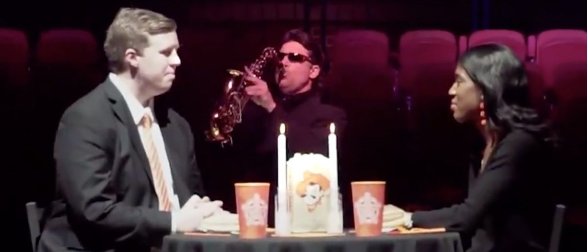 Mike Gundy playing the saxophone (Credit: Screenshot/Twitter Video Oklahoma State)