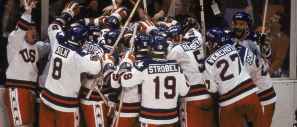 """LAKE PLACID, NY - FEB 22: Team USA celebrates their 4-3 victory over the Soviet Union in the semi-final Men's Ice Hockey event at the Winter Olympic Games in Lake Placid, New York on February 22, 1980. The game was dubbed """"the Miracle on Ice"""". The USA went on to win the gold medal by defeating Finland 4-2 in the gold medal game. (Photo by Steve Powell /Getty Images)"""