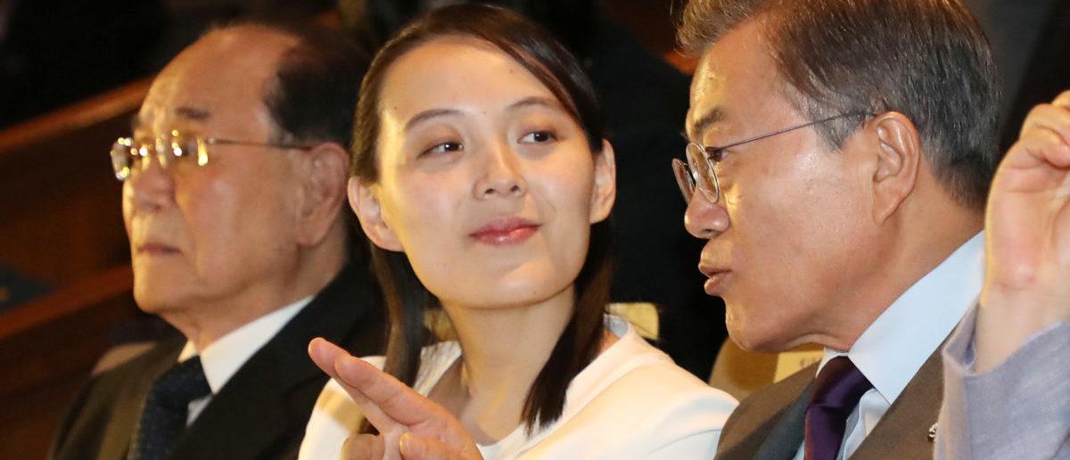 South Korean President Moon Jae-in talks with Kim Yo Jong, the sister of North Korea's leader Kim Jong Un, while watching North Korea's Samjiyon Orchestra's performance in Seoul, South Korea, February 11, 2018. Yonhap via REUTERS