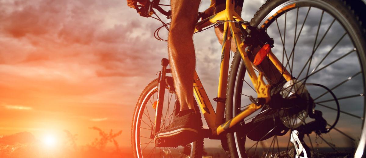 Mountain Bike cyclist riding single track outdoor. (Shutterstock/Oleksiy Rezin)