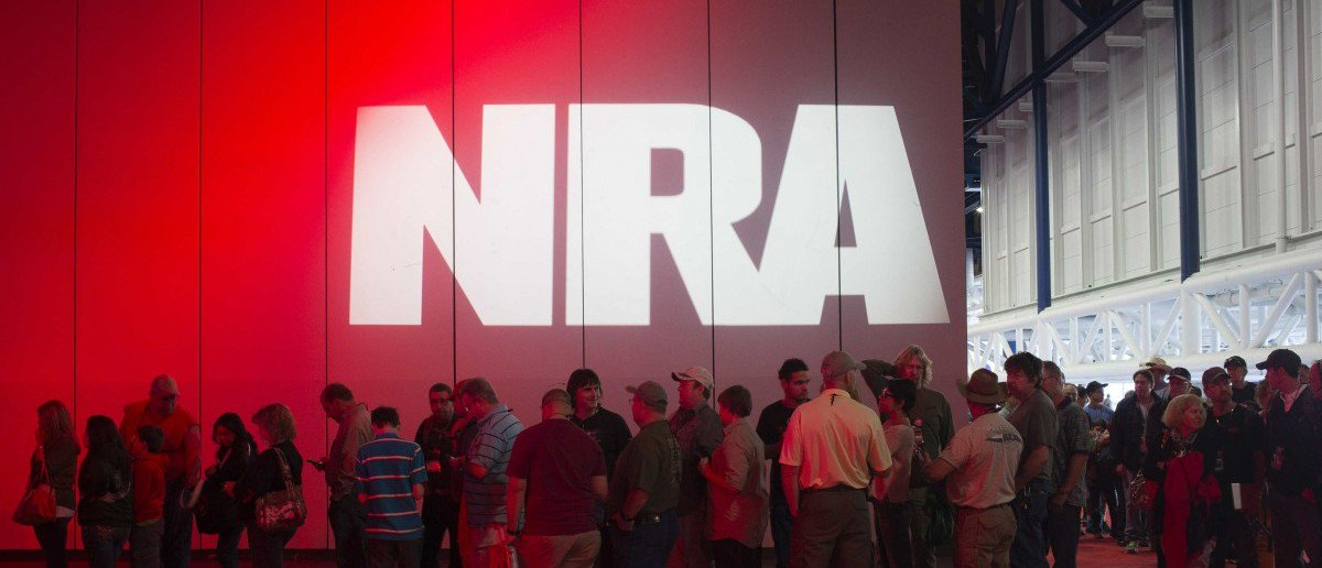 Attendees line-up to meet musician Ted Nugent (not pictured) at a book signing event during the National Rifle Association's annual meeting in Houston, Texas on May 5, 2013. (REUTERS/Adrees Latif)