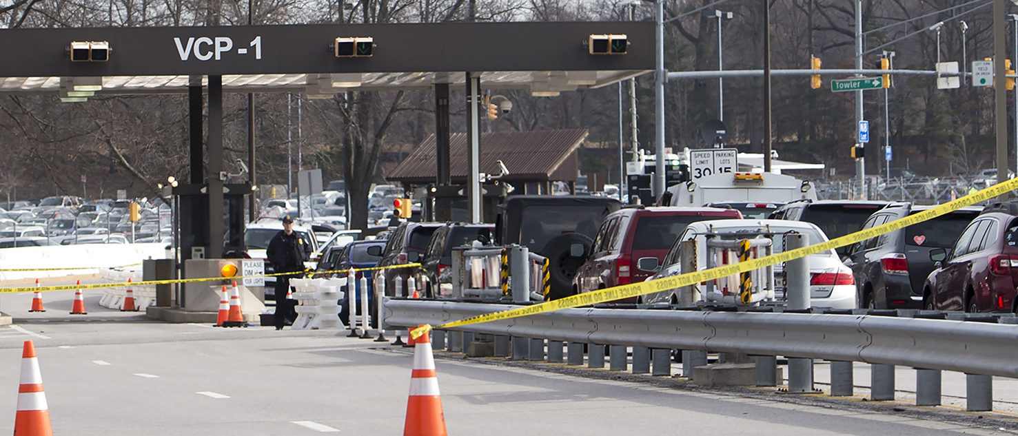 Aerial footage of the scene from NBC News showed a black SUV with numerous bullet holes in its windshield crashed into concrete barriers at the main entrance to the NSA's headquarters in Fort Meade, Maryland. SAUL LOEB/AFP/Getty Images