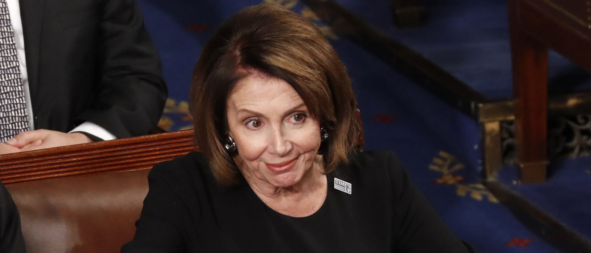House Minority Leader Nancy Pelosi reacts to U.S. President Donald Trump's State of the Union address to a joint session of the U.S. Congress on Capitol Hill in Washington, U.S. January 30, 2018. REUTERS/Jonathan Ernst