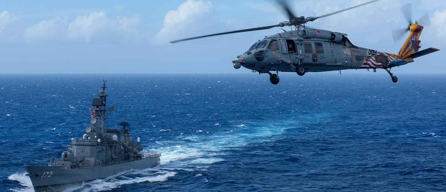 A U.S. MH-60S Sea Hawk flies by Japan's Maritime Self-Defense Force ship JS Shimakaze above waters around Okinawa southwest of the Korean peninsula, October 9, 2017. U.S. Navy/Mass Communication Specialist 2nd Class Kenneth Abbate/via REUTERS