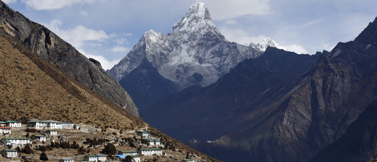 Mount Ama Dablam is seen behind Khumjung a typical Sherpa village in Solukhumbu District also known as the Everest region, in this picture taken November 30, 2015. To match Insight QUAKE-NEPAL/SHERPAS REUTERS/Navesh Chitrakar