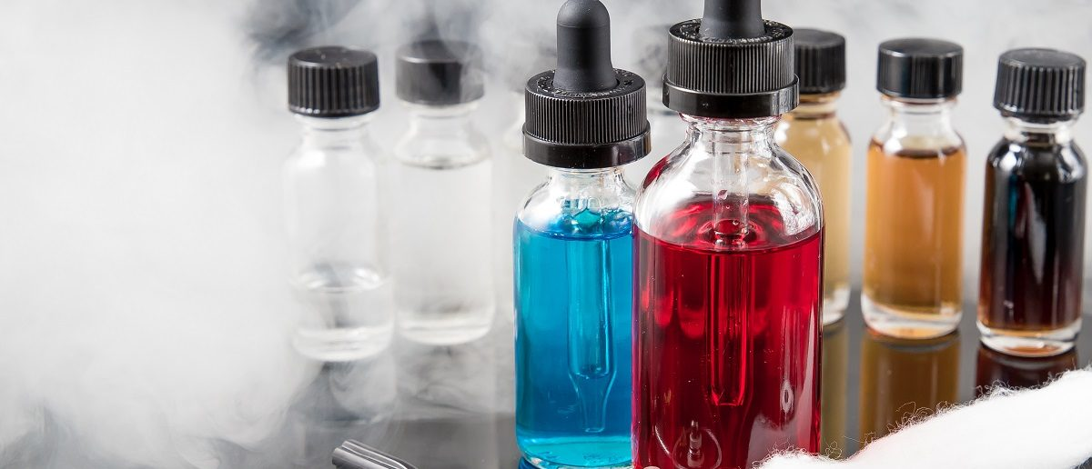 Vaporizer smoke with juice bottles, screwdriver and cotton wick with tools. (Rain Ungert/Shutterstock)