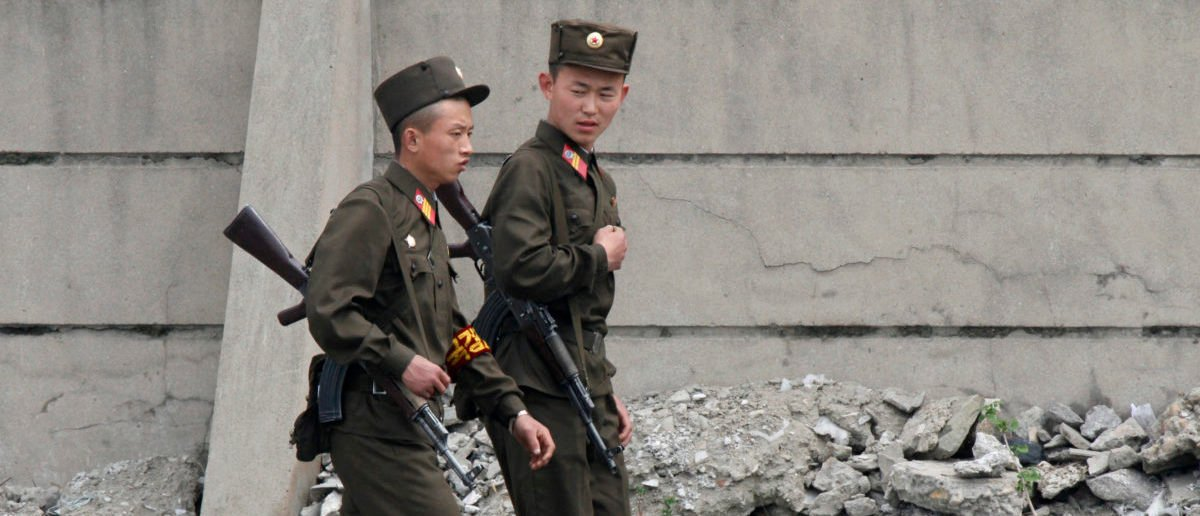 Armed North Korean soldiers patrol the banks of Yalu River near the North Korean town of Sinuiju, opposite the Chinese border city of Dandong, May 20, 2011. Confusion surrounded a North Korean visit to China on Friday, as media in the South said the North's leader Kim Jong-il had crossed the border, contradicting earlier reports that his son and heir apparent Kim Jong-un had travelled. REUTERS/Jacky Chen