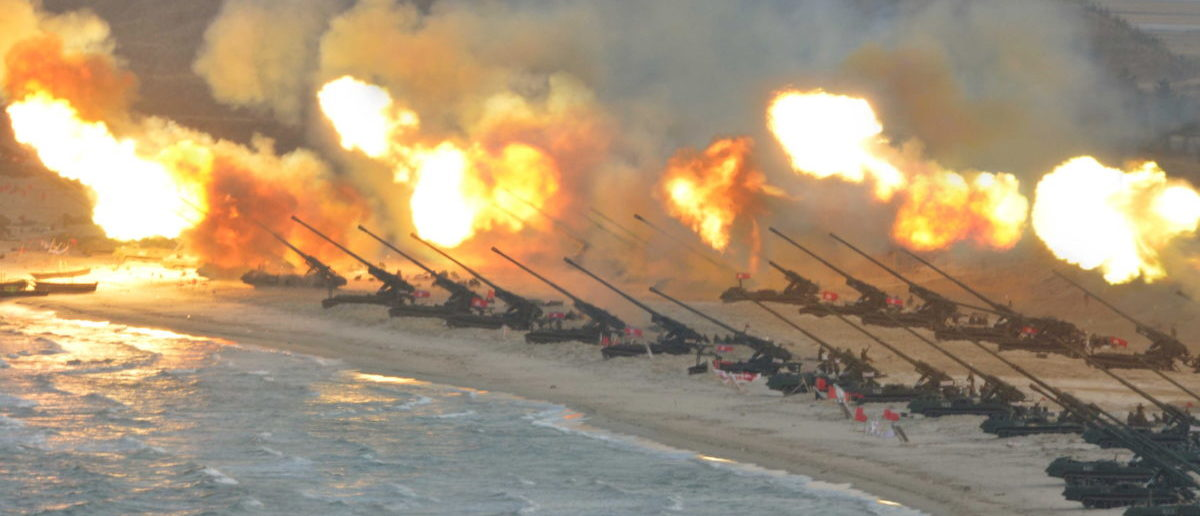 Artillery pieces are seen being fired during a military drill at an unknown location, in this undated photo released by North Korea's Korean Central News Agency (KCNA) on March 25, 2016. REUTERS/KCNA