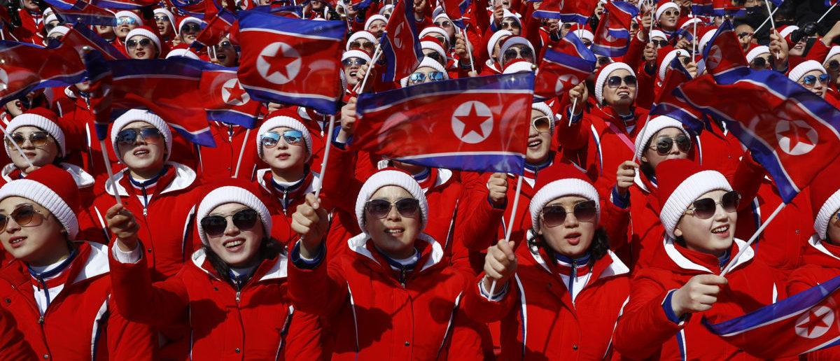 Alpine Skiing - Pyeongchang 2018 Winter Olympics - Men's Slalom - Yongpyong Alpine Centre - Pyeongchang, South Korea - February 22, 2018 - North Korean cheerleaders wave flags. REUTERS/Kai Pfaffenbach